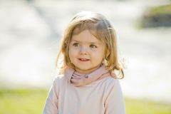 Girl with smile on adorable face on natural background stock images