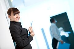 Girl with smile in black jacket with blue folder royalty free stock images