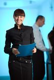 Girl with smile and with blue folder and men royalty free stock photo
