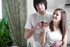 Girl with smile and boy with wineglasses Stock Photography