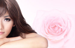 Girl smile face close up with pink rose background Stock Photos