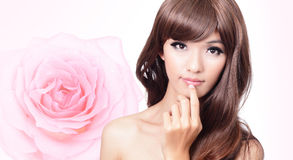 Girl smile face close up with pink rose background Stock Image