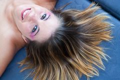 Girl with smile and hair spread out Stock Photography