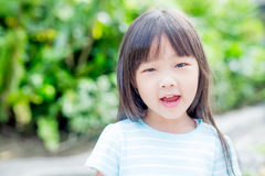 Girl smile happily in park Royalty Free Stock Photos