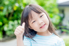 Girl smile happily in park Royalty Free Stock Photo
