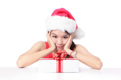 Girl smile and happy look Christmas gift. Young santa girl smile and happy look Christmas gift isolated on white background, model is a asian woman Stock Image