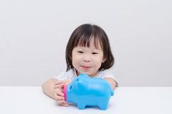 Girl smile with piggy bank Stock Photo