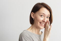 Girl with a smile shares the secret Stock Photos