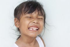 Girl smile showing first the permanent teeth. stock photos