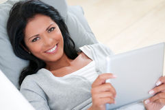 Girl smile with tablet Royalty Free Stock Photos