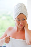 Girl with smile in white towel Stock Image