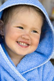 Girl smiles. The girl in a blue hood smiles Royalty Free Stock Photos
