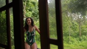A girl smiles in a bungalow stock video