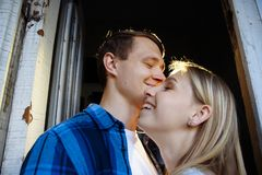 Girl smiles.Close-up of kissing and embracing couples in old, doorway, family. date, attraction. family happiness. Girl smiles. Close-up of kissing and embracing royalty free stock images