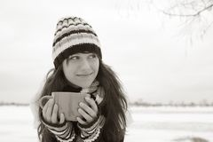 The girl smiles and holding a cup Stock Photography