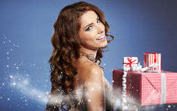 Girl smiles and holding a gift Royalty Free Stock Image