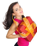 Girl smiles and holding a gift box Stock Photo