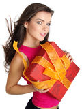 Girl smiles and holding a gift box stock images
