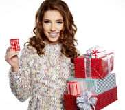 girl smiles and holding a gift in magic packing Royalty Free Stock Photography