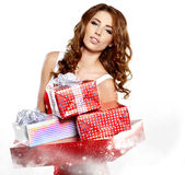 Girl smiles and holding a gift in magic packing Stock Photography