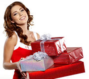 Girl smiles and holding a gift in magic packing Royalty Free Stock Photo