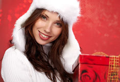 Girl smiles and holding a gift in packing Royalty Free Stock Images