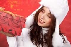 Girl smiles and holding a gift in packing Stock Photography