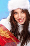 Girl smiles and holding a gift in packing Royalty Free Stock Photography