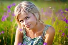 Girl smiles on meadow Royalty Free Stock Photos