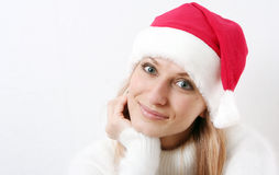 Girl smiles in a New Year's cap Stock Photography