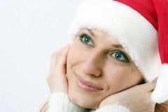 Girl smiles in a New Year's cap Stock Photos