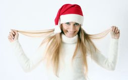 Girl smiles in a New Year's cap Royalty Free Stock Image