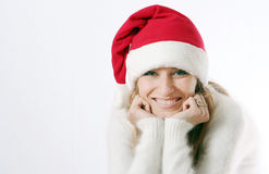 Girl smiles in a New Year's cap Stock Photo