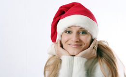 Girl smiles in a New Year's cap Royalty Free Stock Photo