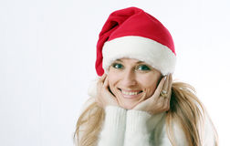 Girl smiles in a New Year's cap Royalty Free Stock Photography