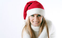 Girl smiles in a New Year's cap Stock Image