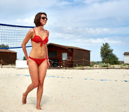 Girl smiles after playing volleyball match on the beach Royalty Free Stock Photography