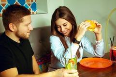Girl smiles shyly to her boyfriend Royalty Free Stock Photos
