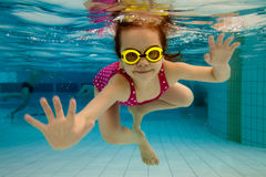 The girl smiles, swimming under stock image