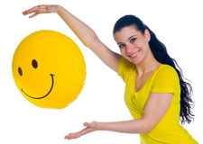 Girl with smiley balloon Royalty Free Stock Image