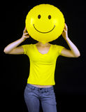 Girl with smiley balloon instead of her face. Teen girl with smiley balloon instead of her face Royalty Free Stock Image