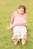Girl with smileys on toes and soles stock images