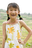 Girl smiling. A Chinese girl is smiling happily in a farm Royalty Free Stock Photo