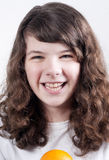 Girl smiling. Long haired teenaged girl smiling,laughing out loud Stock Image