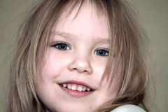 Girl smiling. A smiling blond girl portrait Royalty Free Stock Images