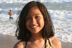 Girl Smiling. Girl standing on the shoreline smiling Stock Image