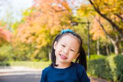 Girl smiling in autumn park stock image