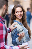 Girl smiling back at stranger Stock Image