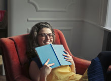 Girl smiling with a book stock photo