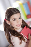 Girl smiling with books Stock Photography